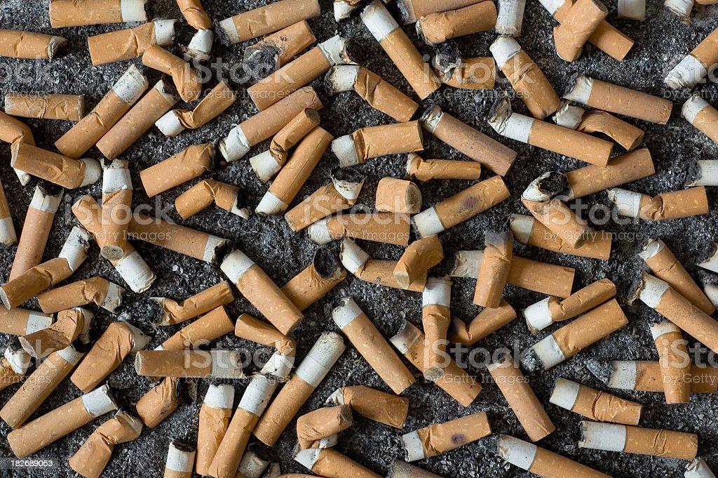 Background of Cigarette Butts and Ash royalty-free stock photo