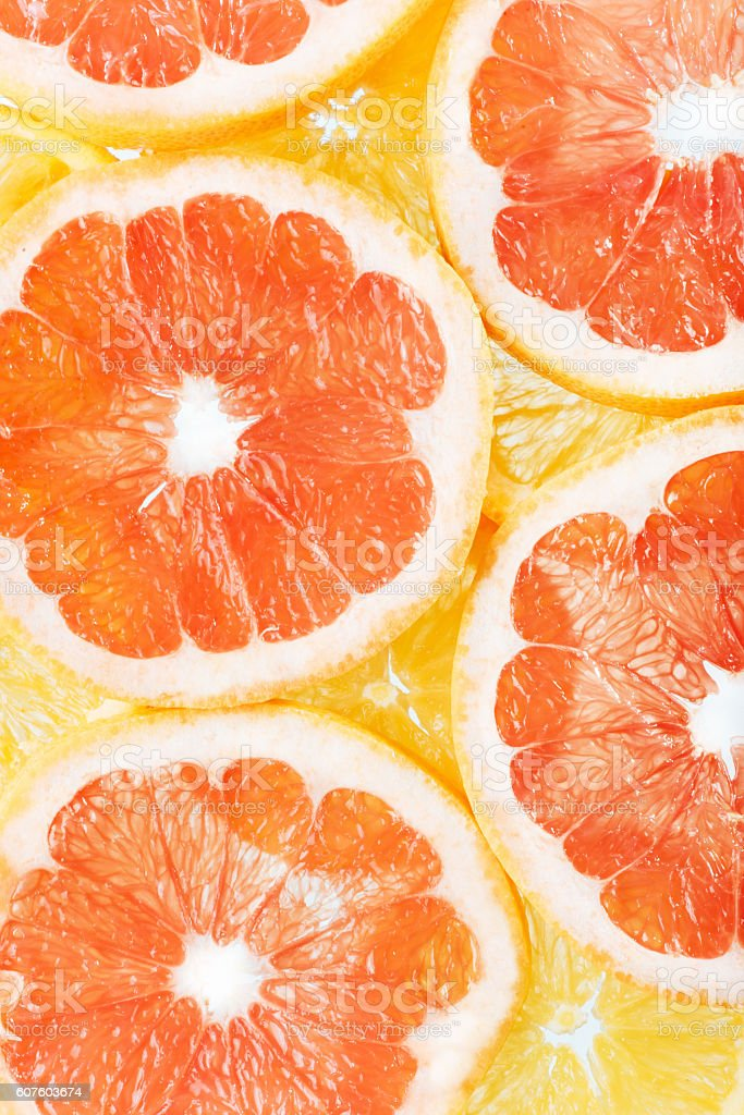 background of citrus fruits oranges and grapefruit slices. stock photo