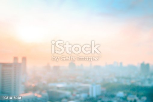 Abstract blurred aerial view city on twilight color sky and clouds