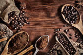 istock Background of coffee beans and grinded coffee on a rustic table 1199797903