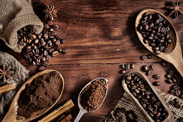 Background of coffee beans and grinded coffee on a rustic table Background of coffee beans and chocolate coffee crop stock pictures, royalty-free photos & images