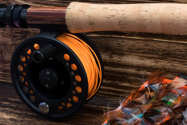 background of coils for fishing rods, close-up view background of coils for fishing rods, close-up view fishing line stock pictures, royalty-free photos & images