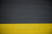 istock Background of color black and yellow garage entrance automatic door 639065402