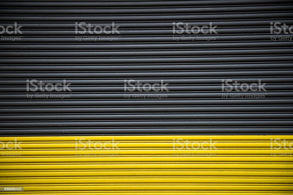 Background of color black and yellow garage entrance automatic door stock photo