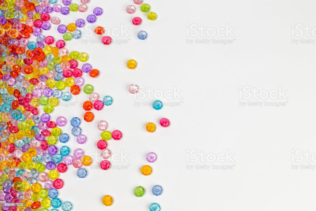 Background of colored beads on a white background stock photo