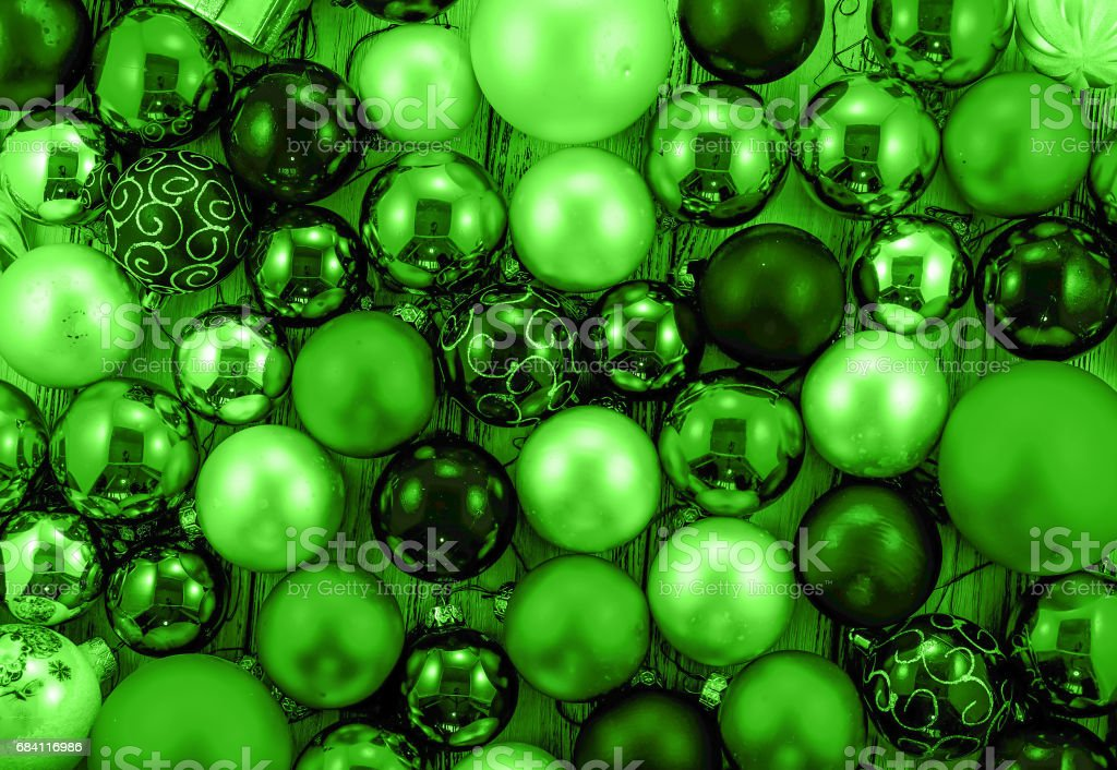 Background of colored Christmas tree balls and decorations green style filtered foto stock royalty-free