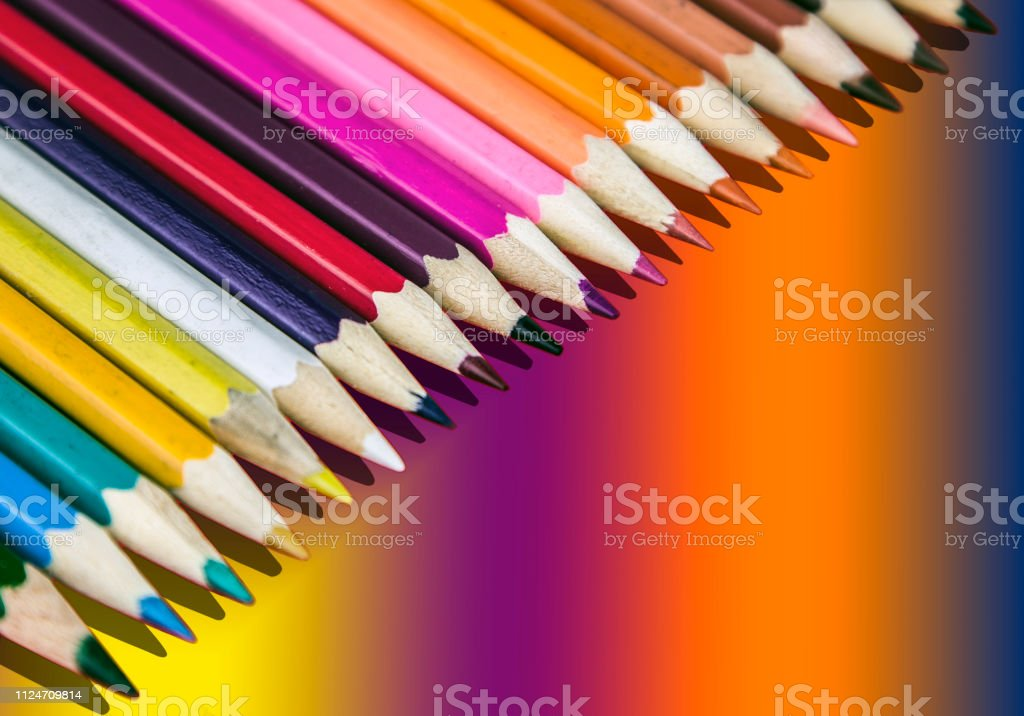 background of colored pencils, with reflection, picture diagonally