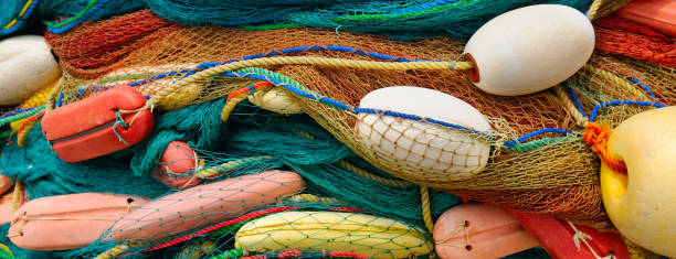 background of colorful fishing nets and floats background of colorful fishing nets and floats fishing net stock pictures, royalty-free photos & images