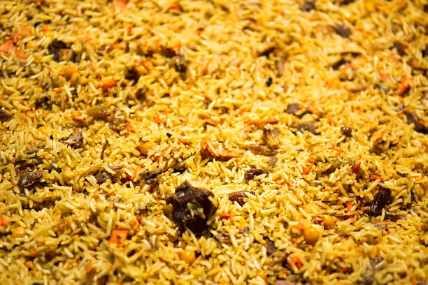 Background of cooked rice yellow Traditional Middle Eastern or Indian dish of rice pilaf cooked with spices. Selective focus muziekfestival stock pictures, royalty-free photos & images