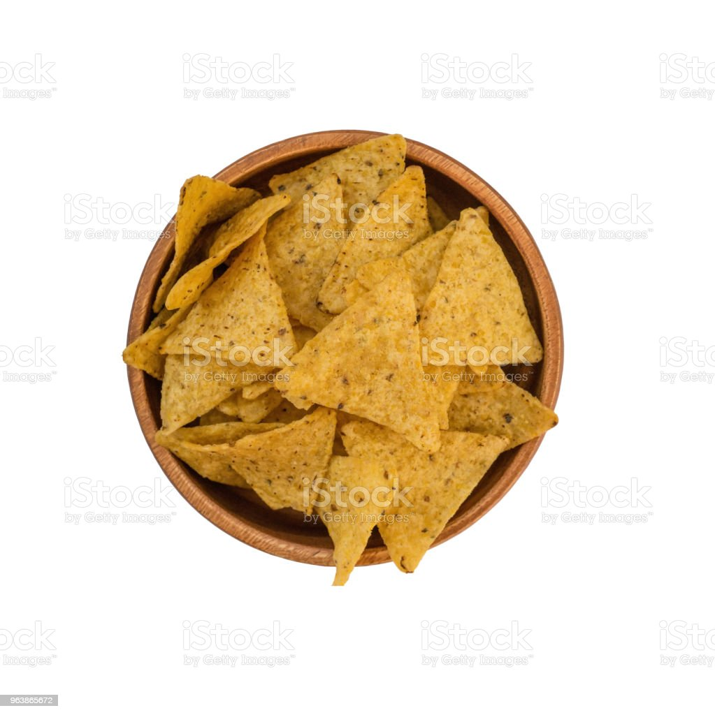 Background of corn tortillas or Nachos fried on an open fire. Isolated on white background - Royalty-free Appetizer Stock Photo