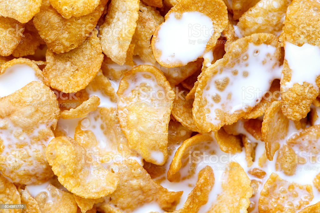 Background of cornflakes in milk from above. stock photo