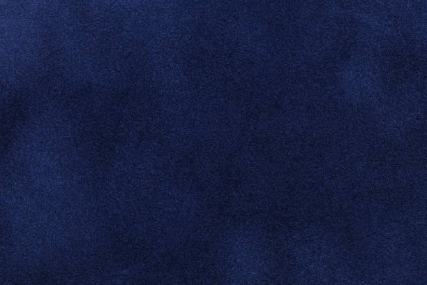 background of dark blue suede fabric closeup. velvet matt texture of navy blue nubuck textile - dark blue stock pictures, royalty-free photos & images