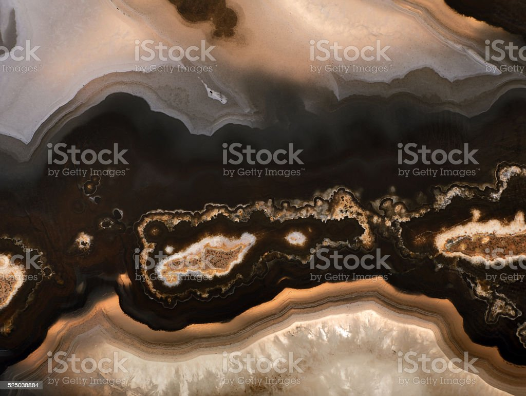 background of dark brown agate structure stock photo