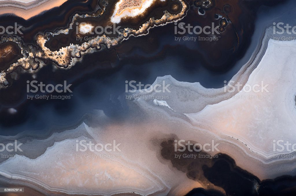 background of dark contrast agate structure stock photo