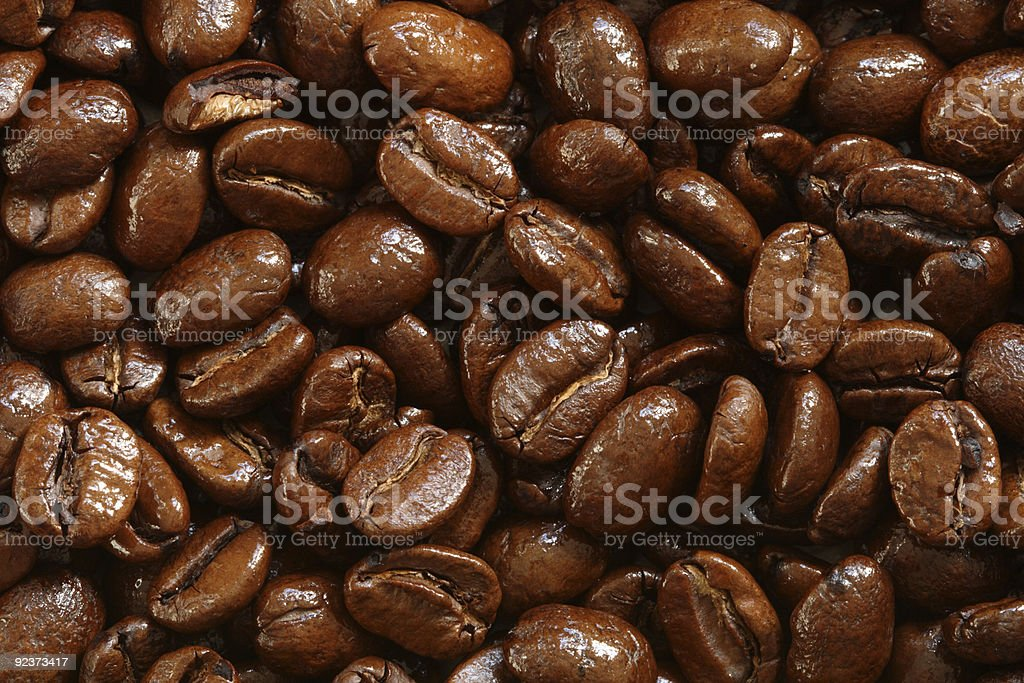 Background of delicious shiny freshly roasted coffee beans royalty-free stock photo