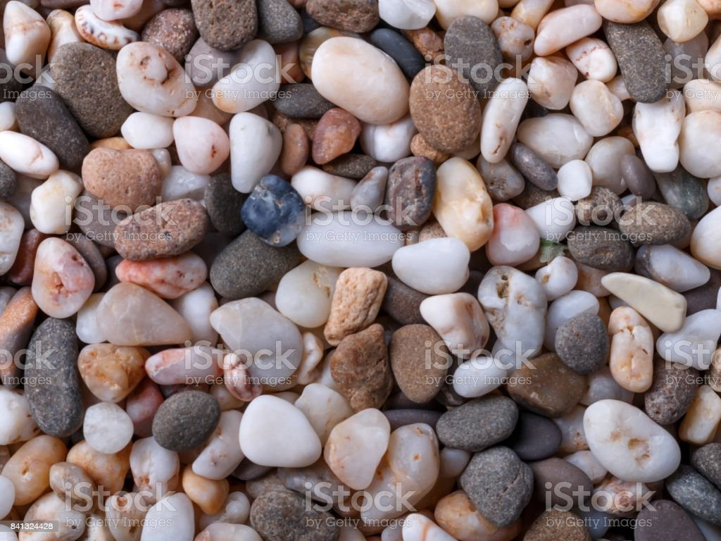 Background of different colors small sea pebbles. stock photo