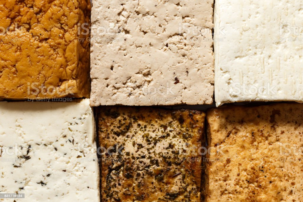 Background of different klinds of tofu blocks from above. stock photo