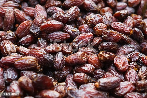 istock Background of dried dates fruit, at the open air market 866894840