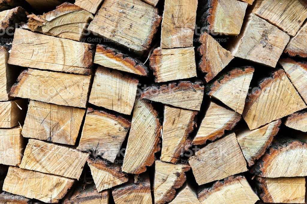 Background of dry chopped firewood logs in a pile stock photo