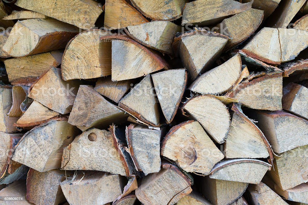 Background of dry chopped firewood logs in pile stock photo