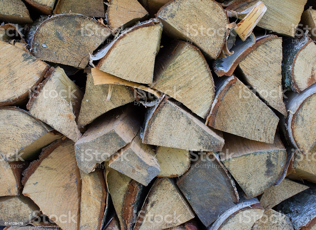 Background of dry chopped firewood logs stock photo