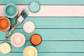 Background of floor boards, paint cans and brush