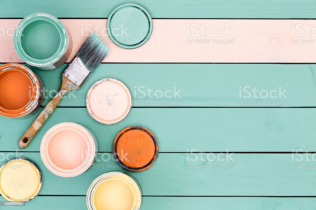 Background of floor boards, paint cans and brush stock photo