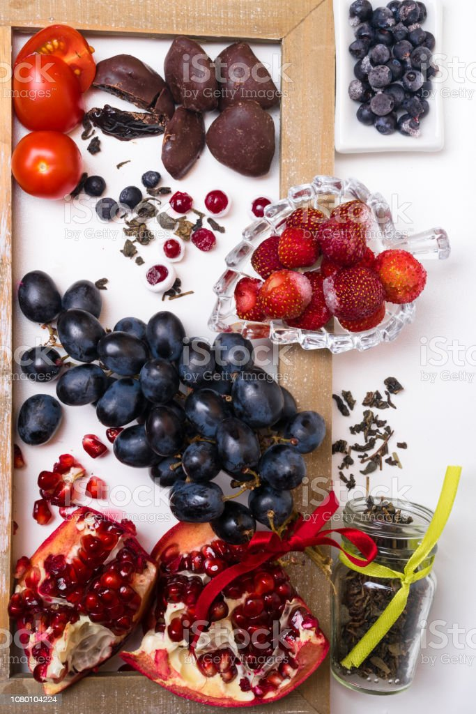 Background Of Food Rich With Resveratrol Grapes Plums Strawberry Dark Chocolatepomegranate Cranberry Green Tea Tomatoes Blueberry Stock Photo Download Image Now Istock