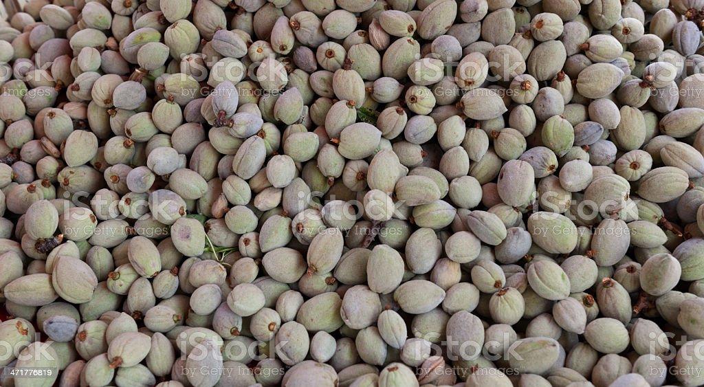 Background of fresh almonds, plenty of fruit royalty-free stock photo