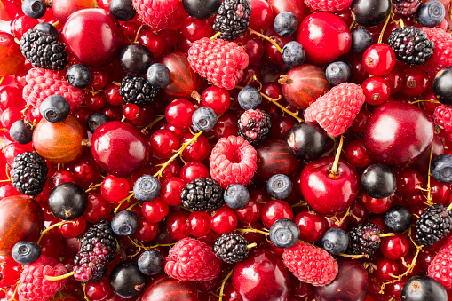 istock Background of fresh berries and fruits. Ripe red currants, bilberries, mulberry, gooseberries, blackcurrants and raspberries. Mixed berries and fruits. Top view. Background berries and fruits. Immunity system improvement. Antiviral treatment. Coronavirus 1223961631
