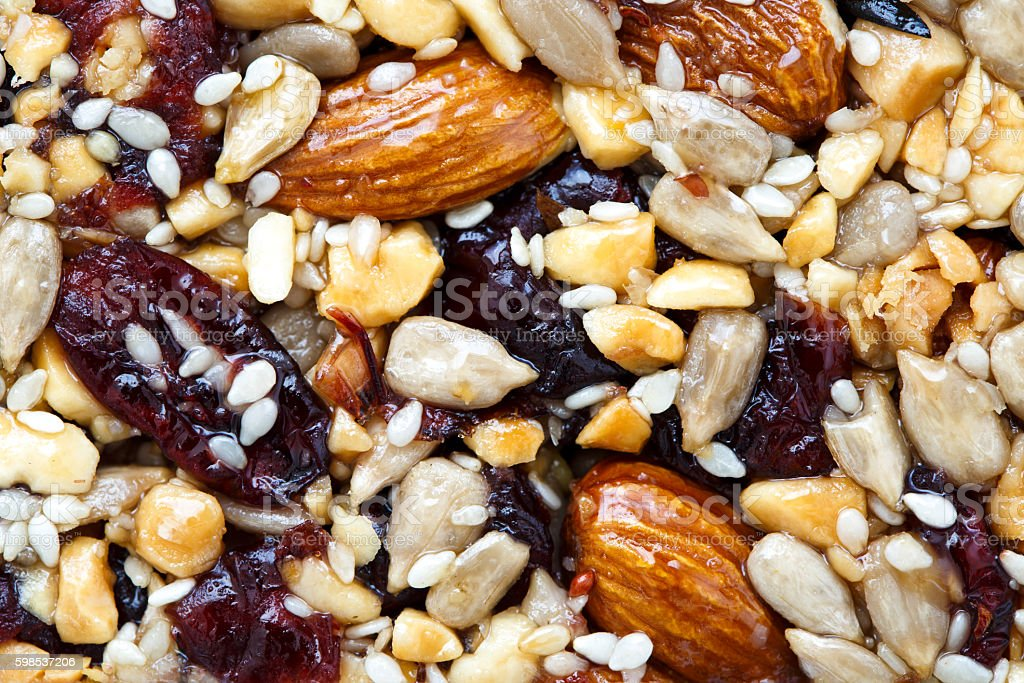 Background of fruit, nut and seed bar with cranberries. photo libre de droits