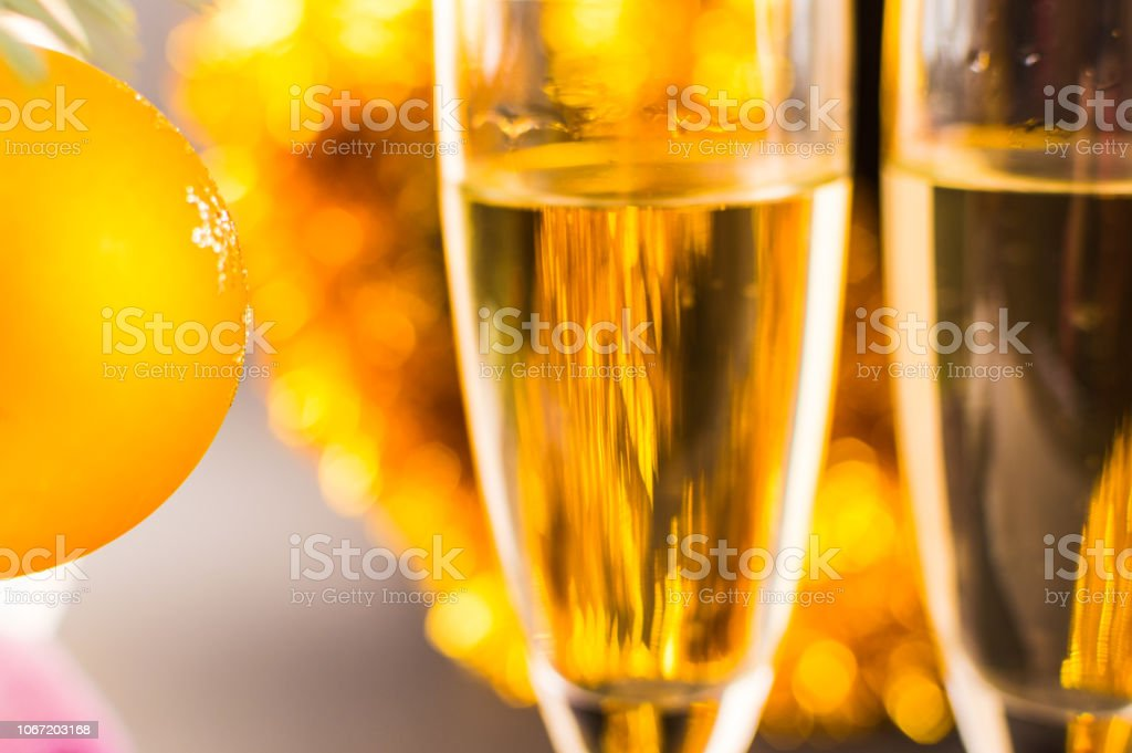 Background of Gold garland and Glasses with champagne.