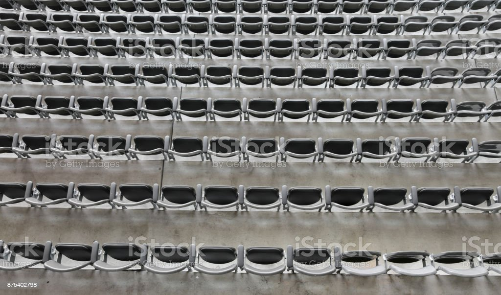 background of gray chairs without the spectators stock photo