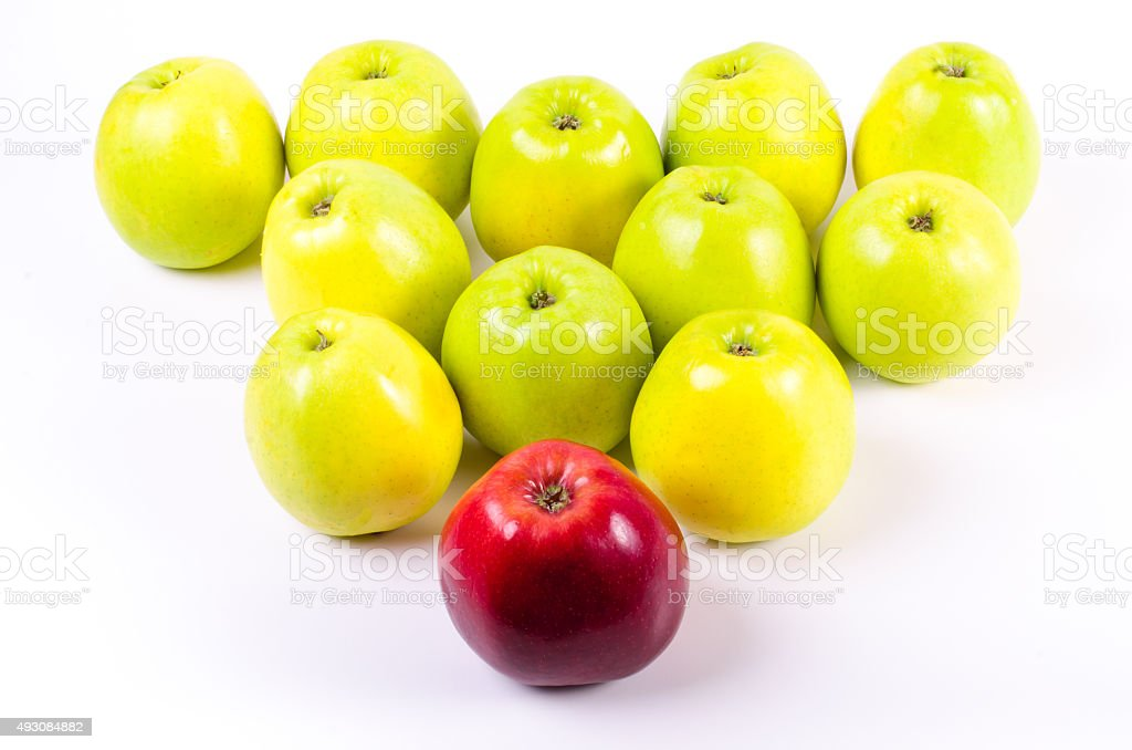Background of green apples with one red apple. Concept stock photo