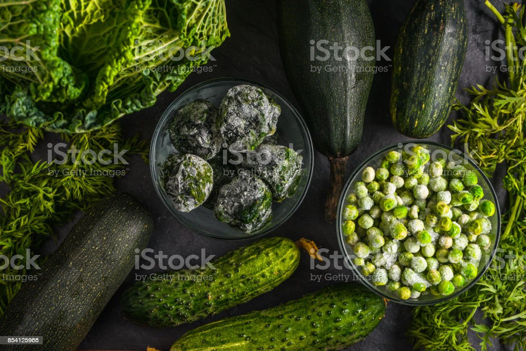 Background of green vegetables of cucumbers, Savoy cabbage stock photo