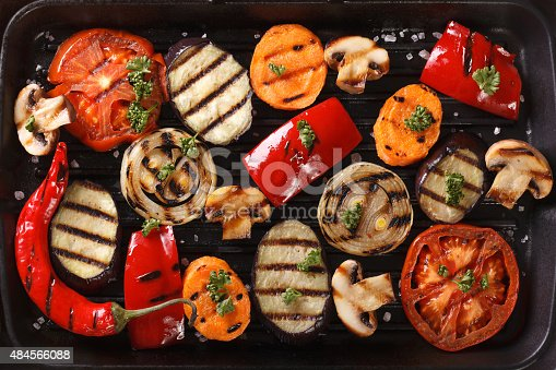 655794674 istock photo Background of grilled vegetables close up. Horizontal top view 484566088