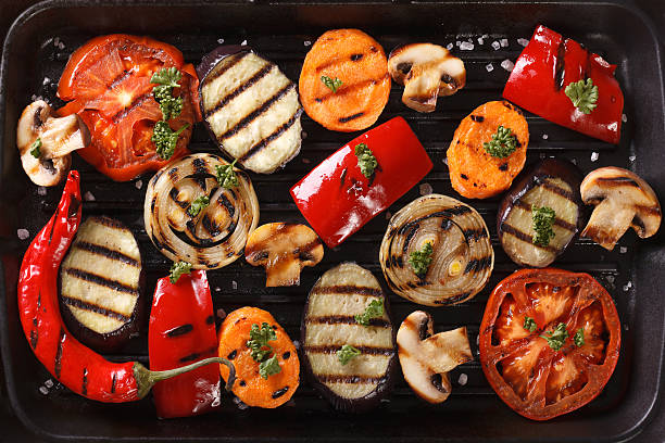 background of grilled vegetables close up. horizontal top view - grilled vegetables stock photos and pictures