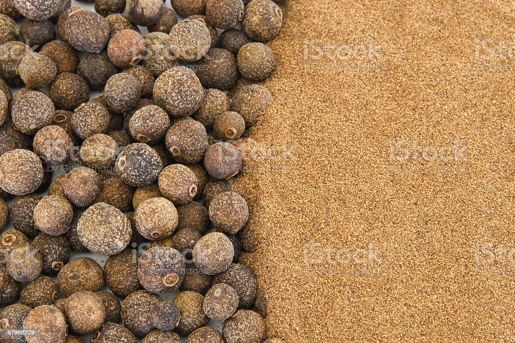 Background of ground and whole allspice royalty-free stock photo