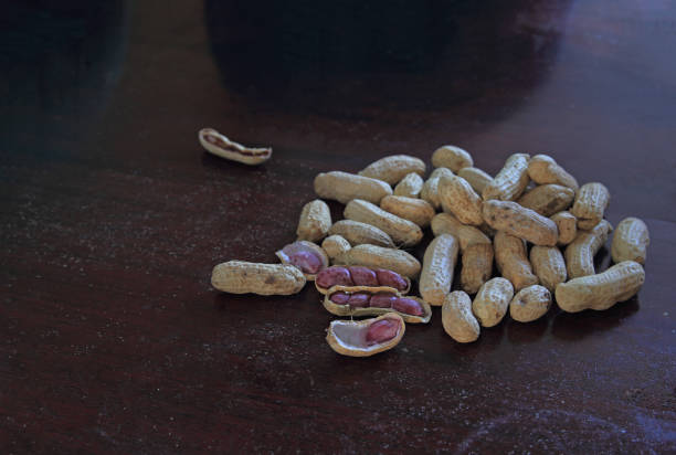 Background of groundnuts or peanut on dark table