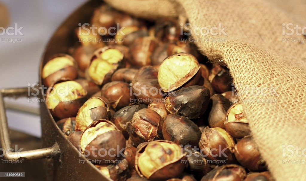 background of hot roasted chestnuts just grilled stock photo