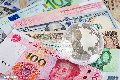 928696036 istock photo Background of international currency notes 1206847560