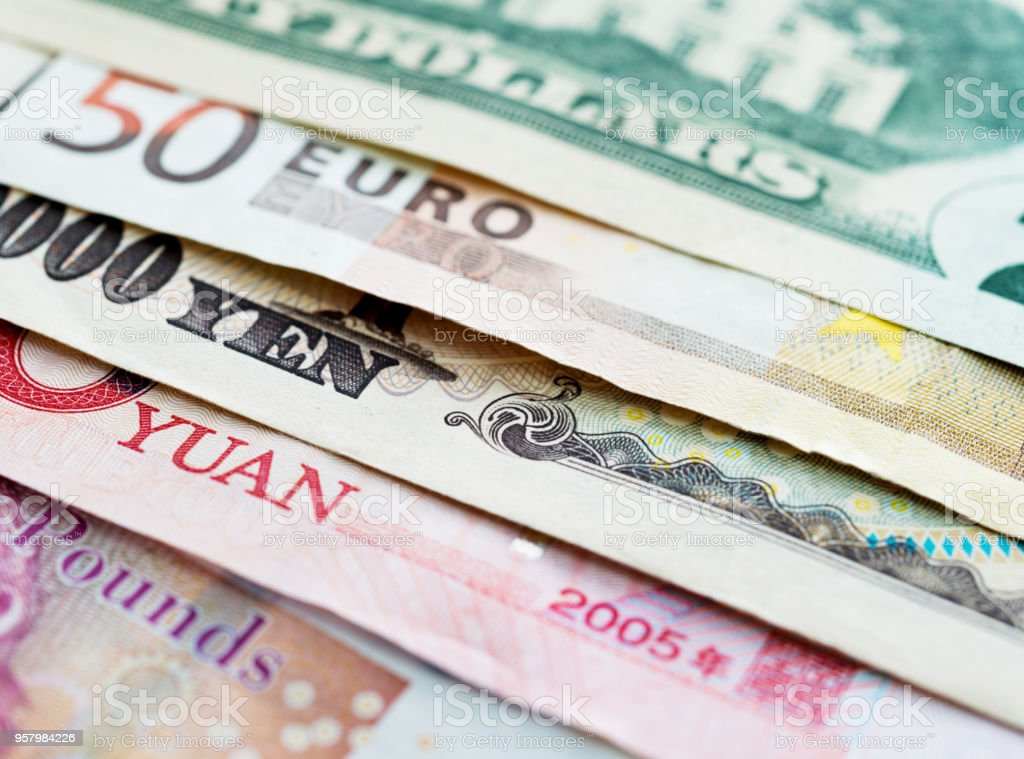 Background of international currency notes stock photo