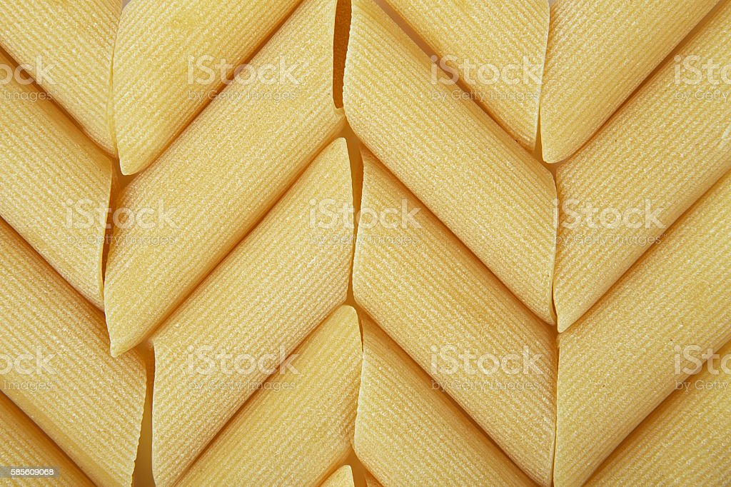background of italian penne, traditional pasta stock photo