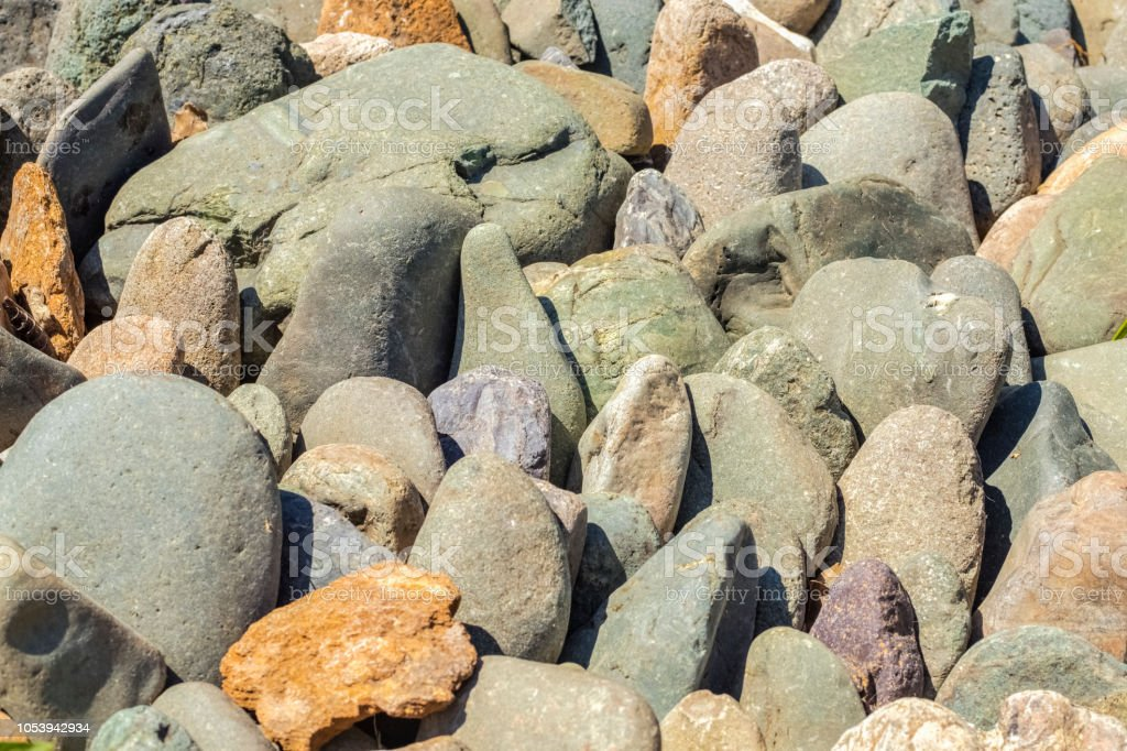 Background of large sea rocks of different breeds stock photo