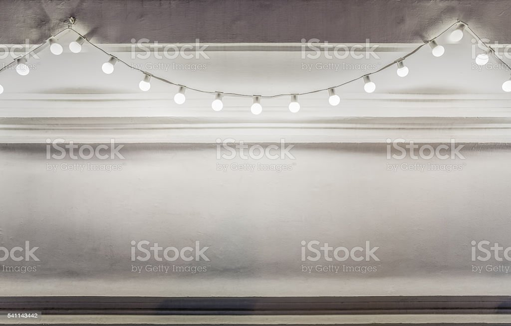Background of light bulbs string stock photo