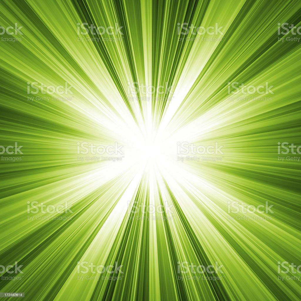 Background of light radiating from the center in green stock photo