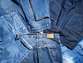Background of many jeans pants