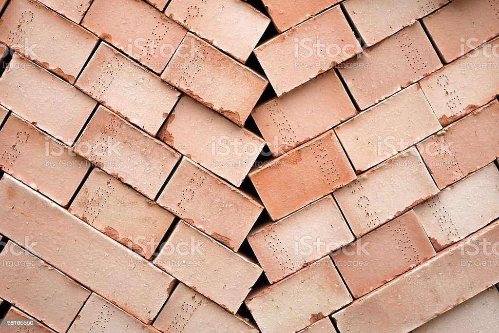 Background of many red bricks for cinstruction in pallet royalty-free stock photo