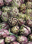 background of many ripe artichokes for sale