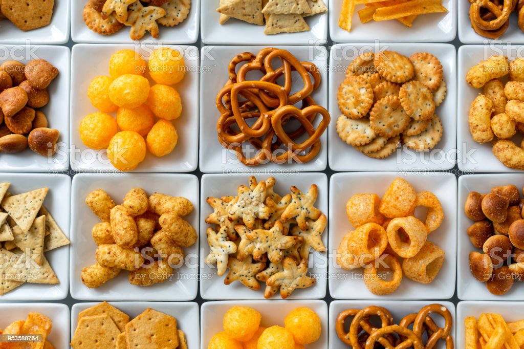 Background Of Many Types Of Savory Snacks In White Square